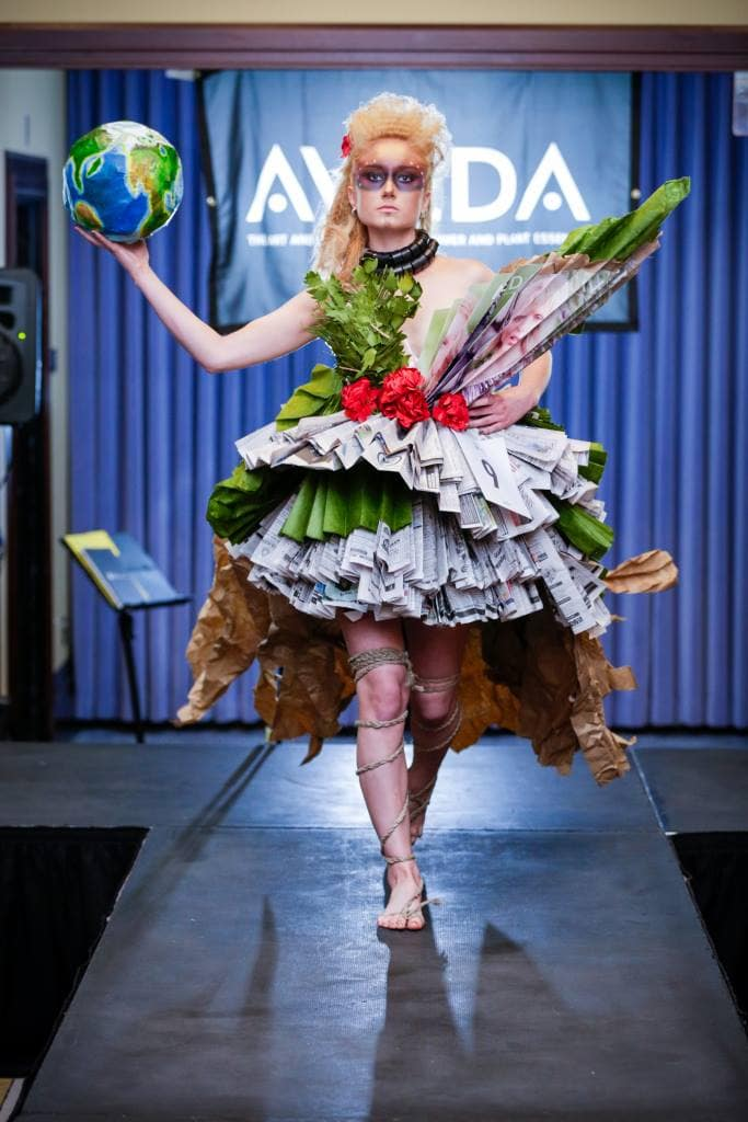 "Debony Salon invites the community to join them as they defend their winning title in the 2016 AVEDA ""Catwalk for Clean Water"" on April 3rd at the Liberty Hotel in Boston. Pictured here is salon cosmetologist, Sarah Jette as an ""Earth Warrior"" with hair, make-up and costuming all created by staff of the salon. For more information, contact the salon at 603-383-9366."